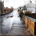 SO4107 : Puddle on Monmouth Road, Raglan by Jaggery