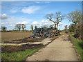 TM2991 : Logs beside farm track near Sexton Wood by Evelyn Simak