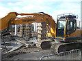 TQ7568 : Columns and excavator, Sun Pier by David Anstiss