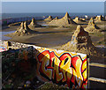 TQ3303 : Eroding sand sculptures by Ian Taylor
