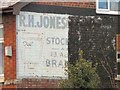 SJ8989 : Half a Ghost Sign by Gerald England