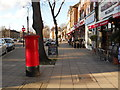 TQ2993 : Row of shops on The Green, Southgate by Paul Bryan