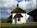 TQ6868 : Thatched lodge in Cobham Park by Marathon