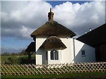 TQ6868 : Thatched lodge in Cobham Park by Marathon