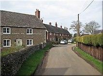 SK8707 : Egleton: a brick row in an ironstone village by John Sutton