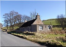 NJ5703 : 'Roadside Cottage' at access to Cairnbeathie (off right) by Stanley Howe