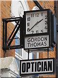 TQ3296 : Clock above Gordon Thomas, Opticians, Church Street, EN2 by Mike Quinn