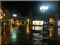 NY3704 : Shopping area at night, Ambleside by Graham Robson
