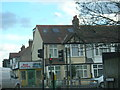 TQ2968 : Bud Flavour Caribbean takeaway and adjacent houses, Manor Road, Merton by Christopher Hilton