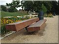 TQ3277 : Hardwood seat, western entrance, Burgess Park, Camberwell by Robin Stott