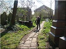TQ3386 : View along the path leading into Stoke Newington Church Street by Robert Lamb