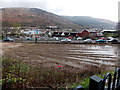 SS9596 : Muddy vacant site at the edge of Treorchy railway station by Jaggery