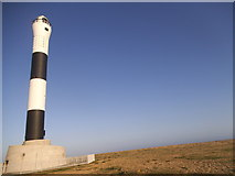 TR0916 : The beach by Dungeness lighthouse by David Howard