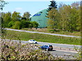SU5947 : Large green structure beside M3 at Junction 7 by Shazz