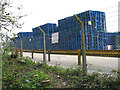 TF9115 : Stacks of blue pallets by Evelyn Simak