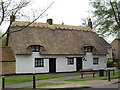 TF1703 : Thatched cottage on Church Street, Werrington by Paul Bryan