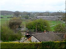 SJ5025 : Railway line and farm buildings near to Lyons Wood by Bikeboy