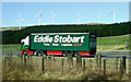 NS9915 : Eddie Stobart truck and wind turbines by Thomas Nugent