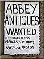 NT4836 : An advertising board at Abbey Antiques, Galashiels by Walter Baxter