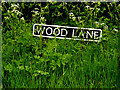 TM4394 : Wood Lane sign by Adrian Cable