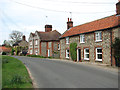TG0539 : Flint and brick cottages in Blakeney Road by Evelyn Simak