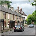 TL2744 : Guilden Morden: contrasting styles in Church Street by John Sutton