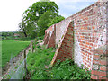 TG2626 : Buttressed wall, Swanton Abbott by Evelyn Simak