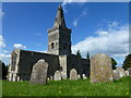 TL1298 : Church and gravestones in Castor by Richard Humphrey