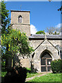 TF9828 : All Saints church - porch and tower by Evelyn Simak