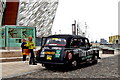 J3575 : Belfast - Titanic Quarter - Black Taxi covered with Messages by Suzanne Mischyshyn
