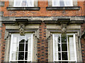 SK4635 : Grotesque heads, Latin House, Risley (1) by Alan Murray-Rust