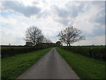 SE9647 : West  of  Lund  minor  road  over  wolds by Martin Dawes