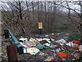 ST0399 : Junk dumped near a danger sign west of Mountain Ash  by Jaggery