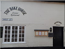 TM0321 : The Bake House and West Street sign by Hamish Griffin