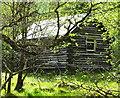 NN2432 : Log cabin at Eas Urchaidh by sylvia duckworth