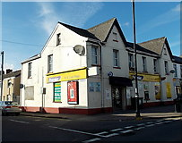 SS7597 : Light and shade on a corner shop in Neath by Jaggery
