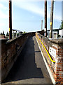 TM4290 : Ramp to the footbridge & Trains by Adrian Cable