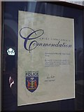 SP7006 : St Mary, Thame: police commendation by Basher Eyre
