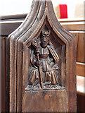 TM1994 : St Mary, Tharston - Bench end by John Salmon