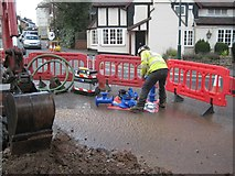 SP0764 : Dealing with a flood, High Street, Studley: 2 by Robin Stott