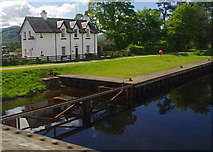 NN1176 : Cottage and pier, Caledonian Canal by Ian Taylor