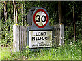 TL8543 : Long Melford Village Name sign by Adrian Cable