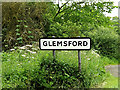 TL8446 : Glemsford Village name sign by Adrian Cable