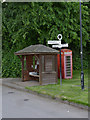 SK7160 : Maplebeck, Bus shelter, fingerpost and telephone kiosk by Alan Murray-Rust