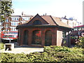 TQ2889 : Closed public toilets on Muswell Hill roundabout by David Howard