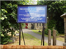 TM0221 : St Lawrence Church, East Donyland sign by Hamish Griffin