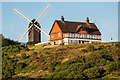 TQ2350 : Reigate Heath Windmill and Reigate Heath Golf Club clubhouse by Ian Capper