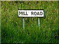 TL9957 : Mill Road sign by Adrian Cable