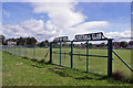 NH5349 : Gates to Muir of Ord Football Club by Richard Dorrell