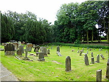 SE5971 : The graveyard at All Saints Church, Brandsby by Ian S